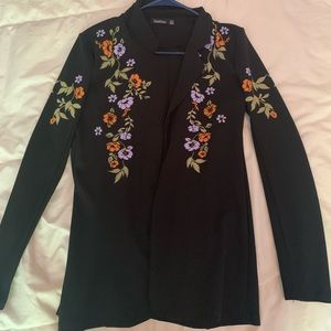 Black blazer with floral accents